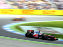 Jenson Button leads Sebastian Vettel on track