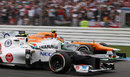 Sergio Perez goes wheel-to-wheel with Nico Hulkenberg