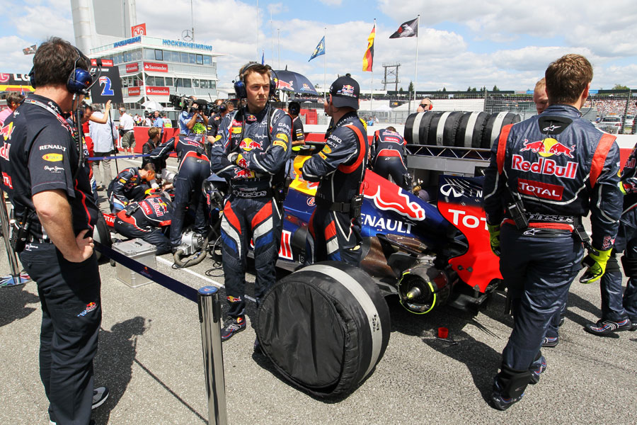Red Bull mechanics on the grid