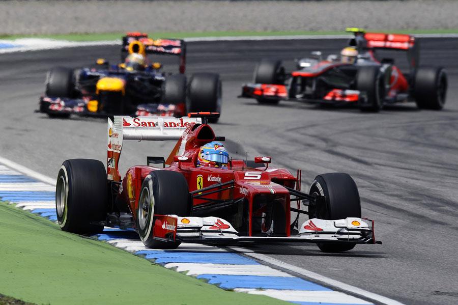 Fernando Alonso leads Sebastian Vettel and Lewis Hamilton