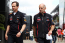Red Bull's Paul Monaghan and Adrian Newey walk to see the stewards