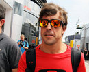 Fernando Alonso arrives in the paddock