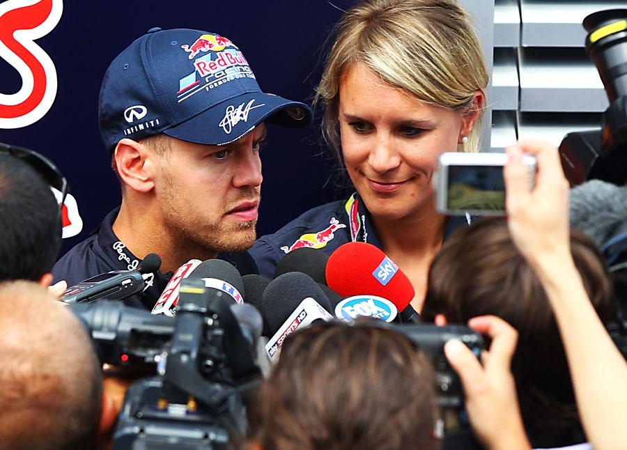 Sebastian Vettel talks to the press in the paddock