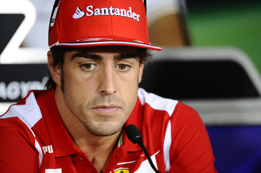 Fernando Alonso deep in thought in the driver press conference