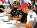 Jenson Button signs autographs on Thursday