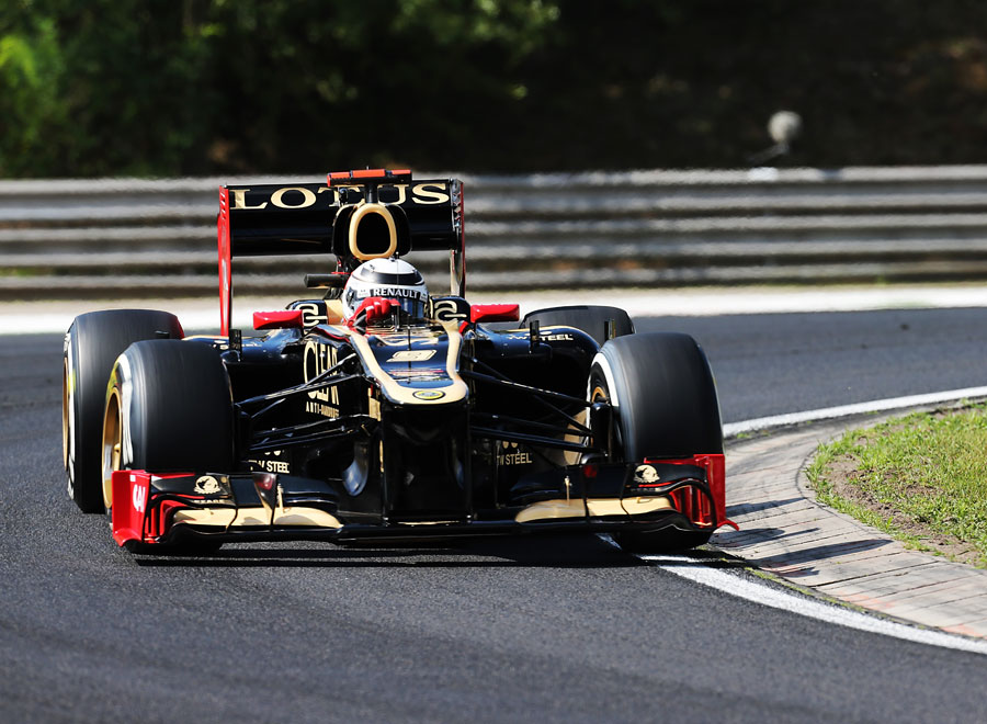 Kimi Raikkonen on track with the Lotus double-DRS on Friday morning
