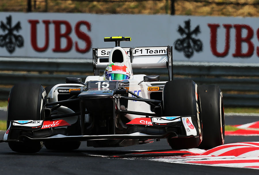 Sergio Perez hops his Sauber over the kerbs