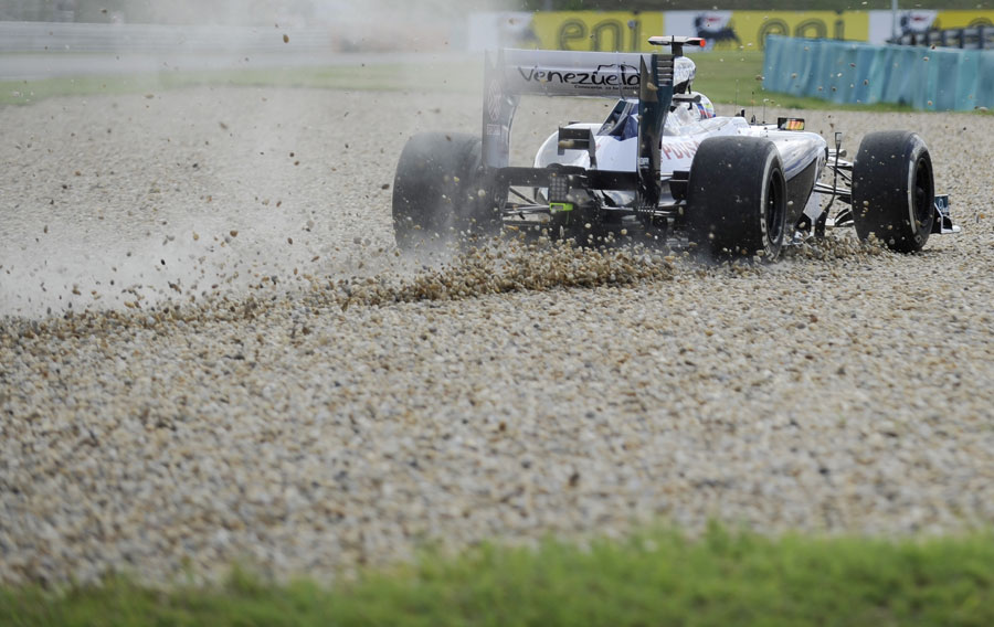 Pastor Maldonado runs through the gravel during FP1