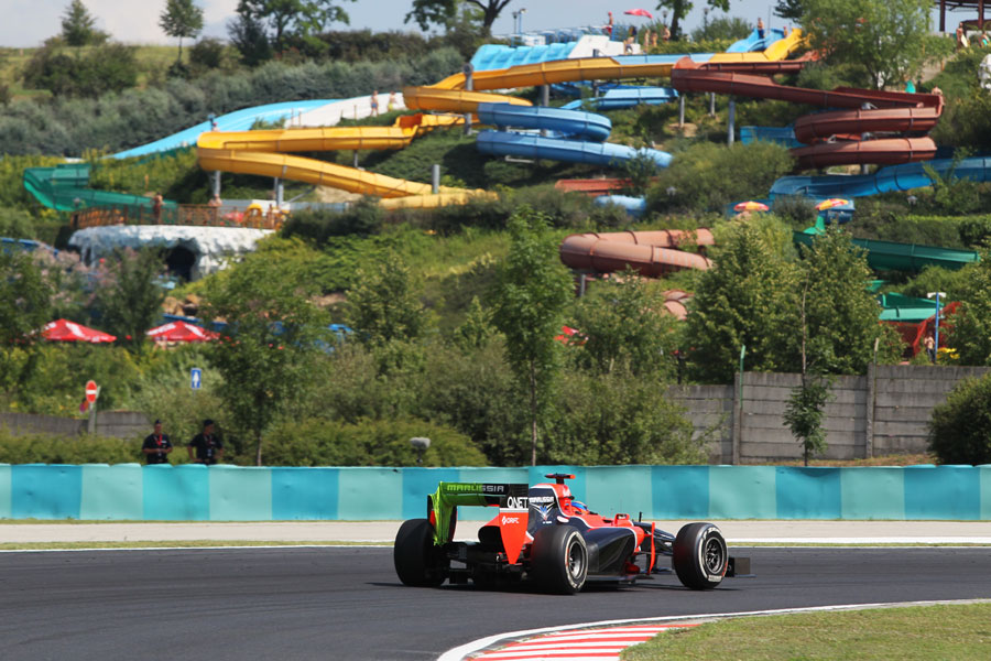 Timo Glock passes the water park with flo-viz paint on his rear wing