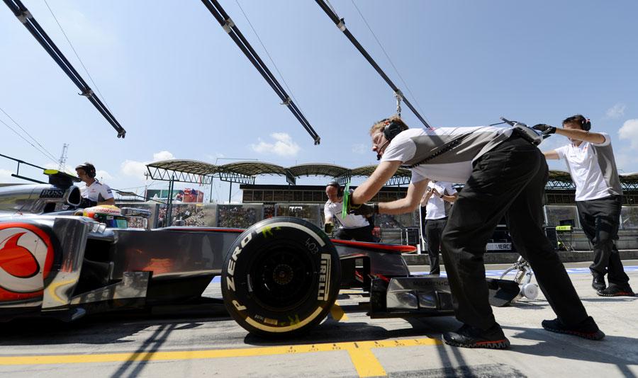 Lewis Hamilton makes a pit stop during a practice session