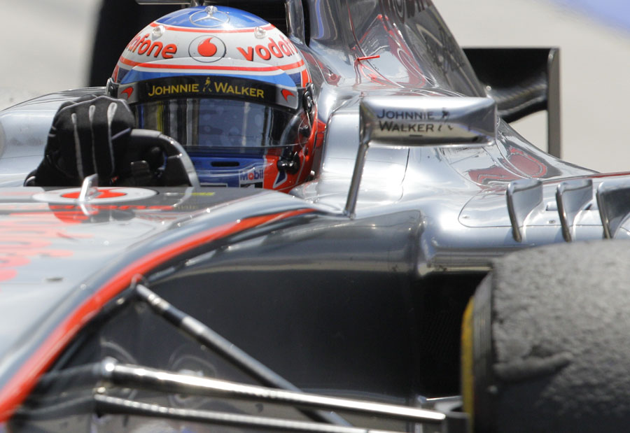 Jenson Button aims for his pit marks as he returns to the pits