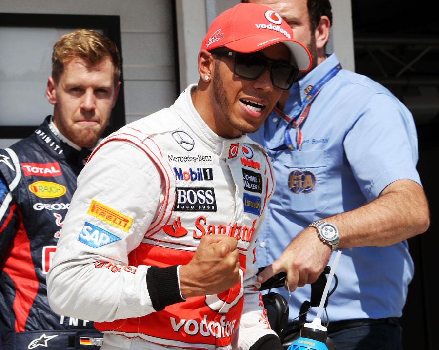 Lewis Hamilton celebrates taking pole position