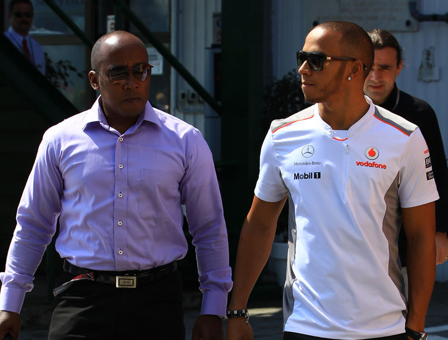 Lewis Hamilton arrives in the paddock with his father Anthony