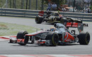 Lewis Hamilton leads Romain Grosjean early in the race