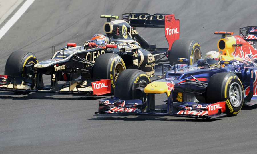 Romain Grosjean holds off Sebastian Vettel in the first corner
