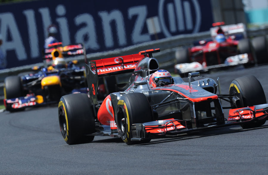 Jenson Button leads Sebastian Vettel and Fernando Alonso on track