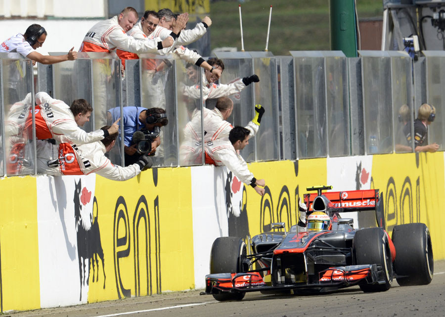 Lewis Hamilton crosses the line to take victory