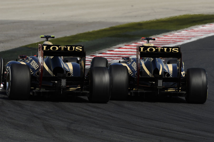 Kimi Raikkonen and Romain Grosjean go wheel-to-wheel for second place