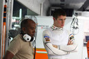 Paul di Resta with his manager Anthony Hamilton in the Force India garage