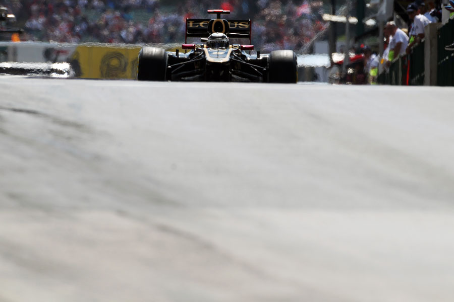 Kimi Raikkonen rolls down the pit lane