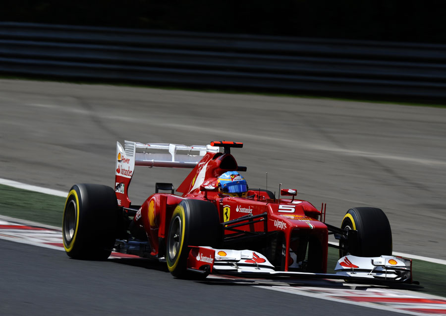 Fernando Alonso opens the DRS on his Ferrari