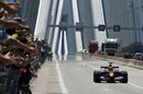 Mark Webber drives his Red Bull across the Rio Antirio bridge