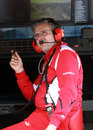 Pat Fry deep in thought on the Ferrari pit wall