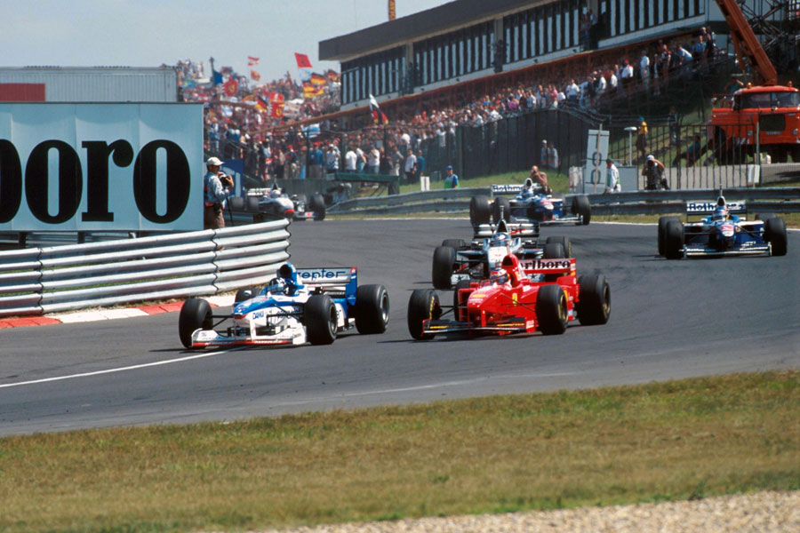 Damon Hill dives down the inside of Michael Schumacher for the lead