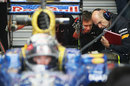 Adrian Newey inspects the rear of the RB8