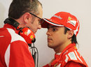 Felipe Massa and Stefano Domenicali in conversation in the Ferrari garage