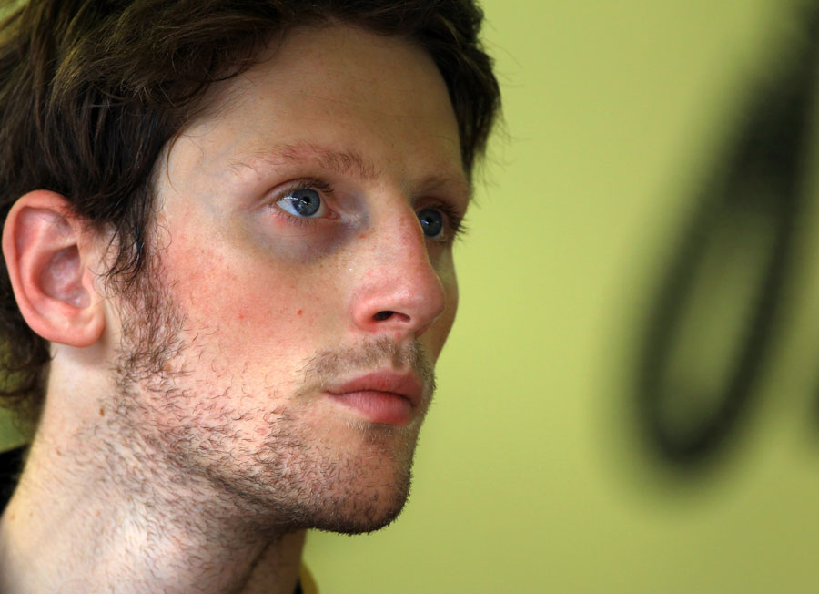 Romain Grosjean in the Lotus garage