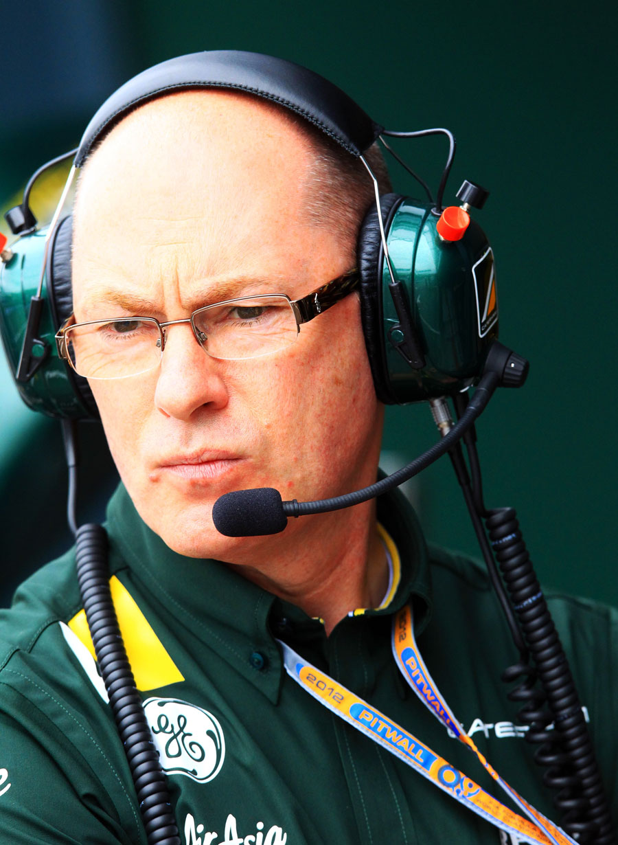 Caterham technical director Mark Smith watches on from the pit wall