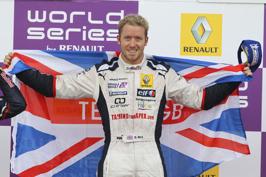 Sam Bird celebrates his race two victory on the podium
