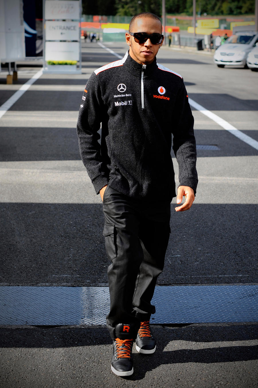 Lewis Hamilton walks through the paddock on Thursday