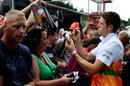 Paul di Resta signs autographs for the fans in the pit lane
