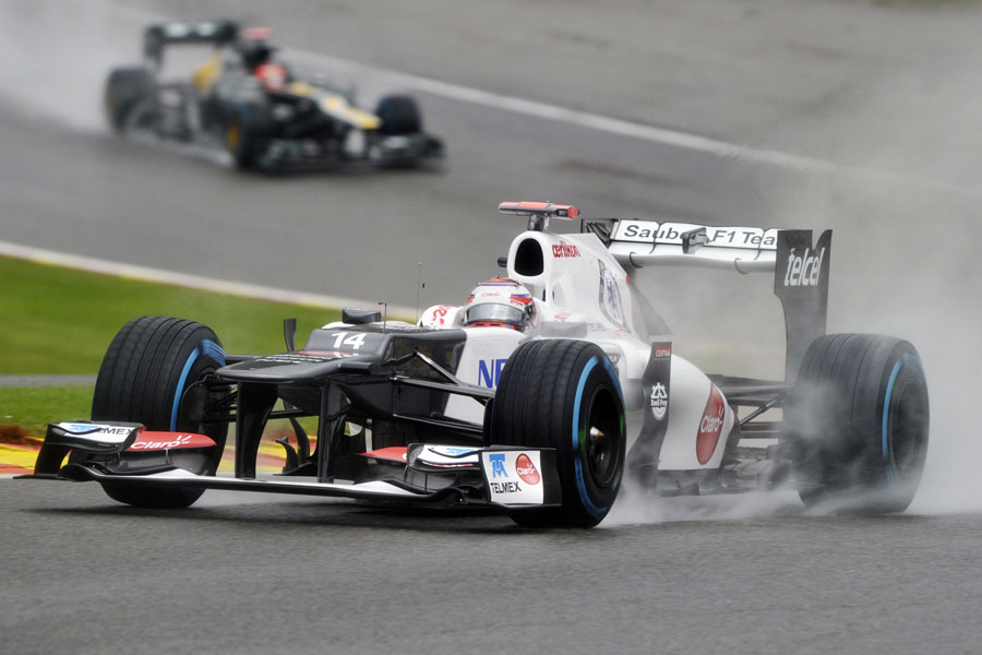 Kamui Kobayashi leads Heikki Kovalainen in the wet
