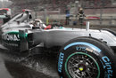 Michael Schumacher leaves the pits on wet tyres