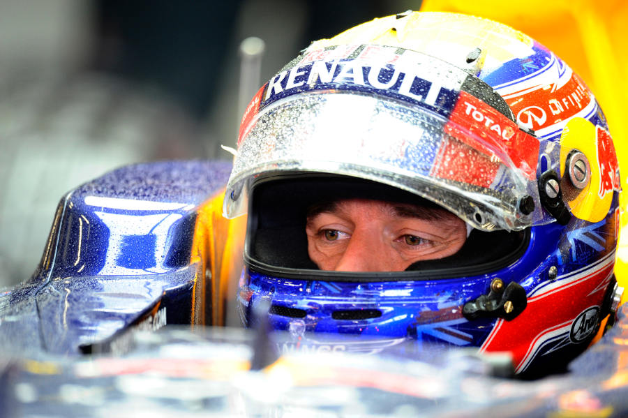 Mark Webber waits in his car following a brief run in the rain