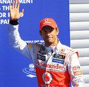 Jenson Button celebrates taking pole position at Spa