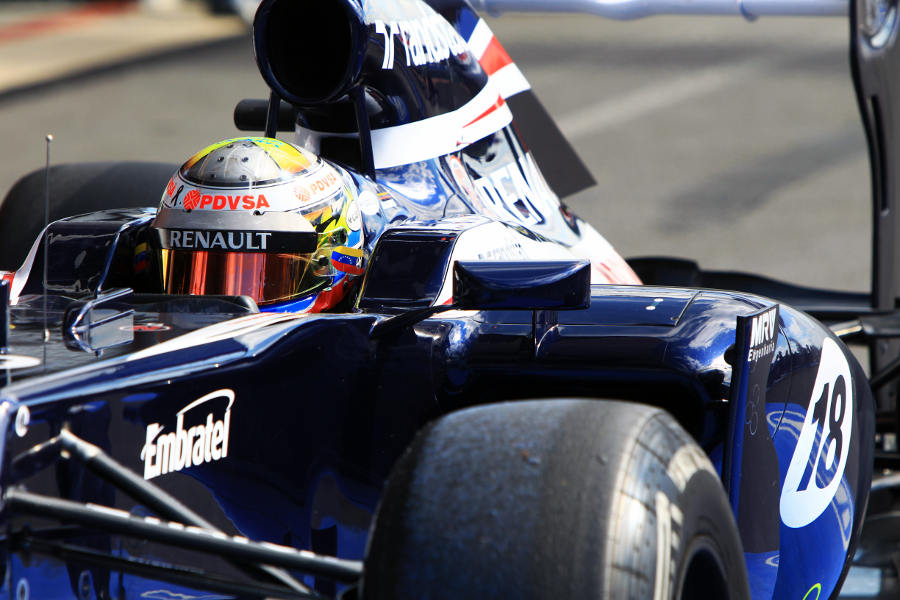 Pastor Maldonado pulls in to Parc Ferme