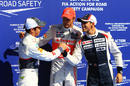 Jenson Button congratulates Kamui Kobayashi and Pastor Maldonado after qualifying