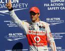 Jenson Button celebrates his pole position