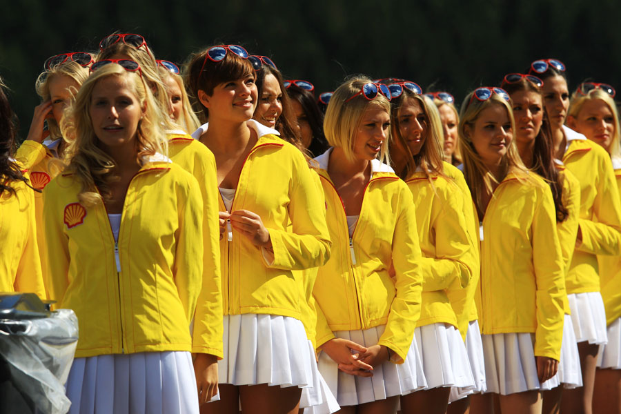 Grid girls wait for the start of the GP2 race
