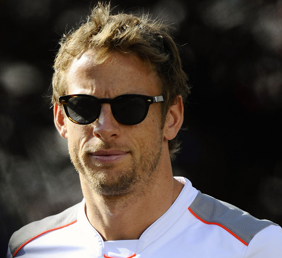 Jenson Button arrives in the paddock