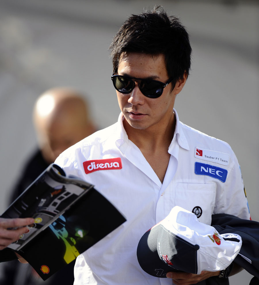 Kamui Kobayashi arrives in the paddock on Sunday morning