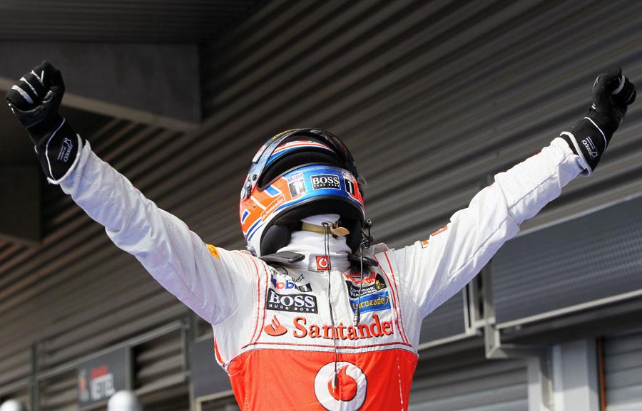 Jenson Button celebrates victory in parc ferme