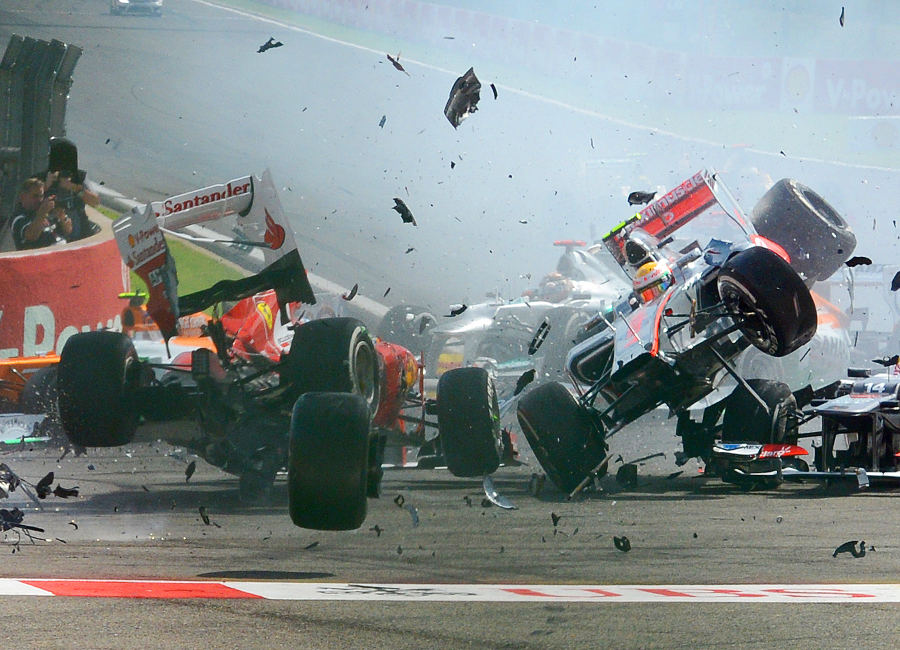 Fernando Alonso and Lewis Hamilton get airborne after being taken out by Romain Grosjean