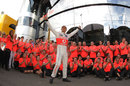 Jenson Button celebrates victory with his team