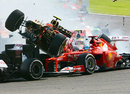 Romain Grosjean passes close to Fernando Alonso's helmet during a first corner accident