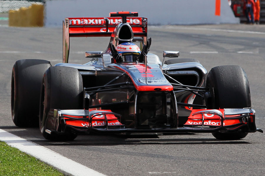 Jenson Button celebrates victory after crossing the line